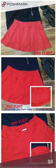 "Big Flirt Red Skort Size Medium Big Flirt Stitched Pleated Red Skort. Skirt with attached shorts underneath and five belt loops around waistband. Log tag on back. Top stitching along hem end, belt loops, pleats and around waist.  65% Polyester * 35% Cotton  Skirt: Approx 12"" Top of Waistband to Hem End Approx 13"" Waist Flat Across  Shorts: Approx 7"" Outseam Approx 1"" Inseam Approx 10"" Leg Opening Flat Across Big Flirt Shorts Skorts"