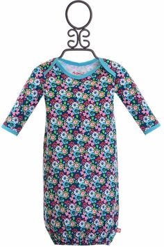 Make a statement this fall in floral with this infant gown by Zutano. Turquoise, pink, green, and red flowers cover this gown with bright blue accents around the sleeves and neckline. With long sleeve Baby Girl Boutique, Baby Gown, Blue Accents, Red Flowers, Infant, Floral Prints, Cold Shoulder Dress, Turquoise, Gowns
