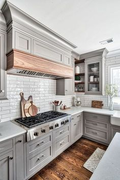 Kitchen hood mantel The custom kitchen hood features a mantel is Natural Walnut hood mantel #hoodmantel #kitchen #hood #kitchenhood