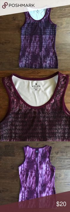 ATHLETA MUSCLE UP 2 TANK TOP Plum Red Dream-maker ATHLETA MUSCLE UP 2 TANK TOP  Color/patten: plum red dream maker Size: XXS  DESCRIPTION: classic Muscle Up Tank gets a style tweak with a breezier neckline for more breathing room during your workouts. MANUFACTURER: Athleta  MANUFACTURERID: 918997 Athleta Tops Tank Tops