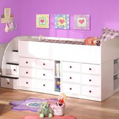 twin bed resting atop oodles of organized storage space. Two sets of six drawers, divided by a narrow cubby, act as a dresser, without using extra floor space! Cubbies on either end of the bed are perfect for storing shoes, books, and toys. Finally, the most unique aspect of this bed, the staircase! The staircase is safer than a ladder and more - the steps are in fact hidden drawers - for even more storage!!!
