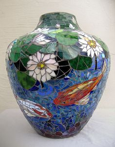 Judith Scallon - blue vase decorated with jewels and blue stained glass