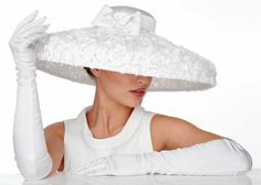 My Little Hat Shop - Simply Audrey large brimmed hat covered with white roses and white silk.