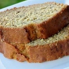 Very moist banana bread containing applesauce and spiced with cinnamon and nutmeg. Raisins and walnuts are optional.