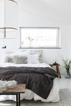 This stunning bedroom reflects the Danish trend of making their homes into hygge havens, with their heavy wood, leather and cosy sheepskin rugs and throws.