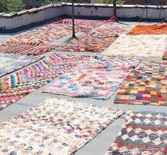 """If you are shopping for rugs in Morocco - know that they are sometimes left on roofs for a long time to """"antique"""" them. But they are still pretty."""