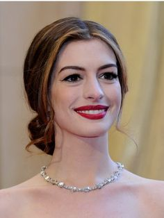 The Low Loop    Gather your hair at the nape of your neck for a timeless look like Anne Hathaways. A middle part and loose ringlets make it feel even more fance.