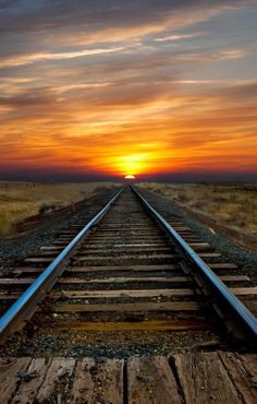 Sunrise over train tracks - every town, large or small, had railroad tracks and the train came to town several times a week or every day. The trains hauled people as well as the products from the farm. Pretty Pictures, Cool Photos, Amazing Pictures, Trains, Beautiful Sunrise, Train Tracks, Train Rides, Ciel, Belle Photo
