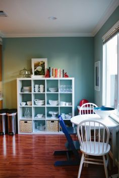 Ikea Expedit shelf in the kitchen! Image from That Wife Blog
