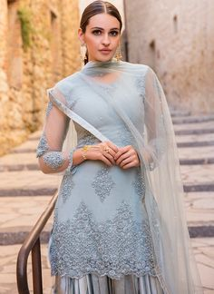 Dusty Blue Grey Embroidered Punjabi Suit features a net kameez with santoon inner, net + santoon bottom and net dupatta. Embroidery work is completed with hand work, stone and lace embellishments all over. Pakistani Gowns, Patiala Salwar Suits, Churidar, Panjabi Suit, Designer Punjabi Suits, Designer Kurtis, Makeup Tips For Brown Eyes, Cute White Dress, Frock For Women
