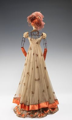 """1800 Doll""  Raphael  (Italian)  Designer: Simone Gange Designer: Casale (French) Designer: Fernand Aubry (French) Date: 1949 Culture: French Medium: metal, plaster, hair, silk, metallic, feather Dimensions: 29 x 13 in. (73.7 x 33 cm) Credit Line: Brooklyn Museum Costume Collection at The Metropolitan Museum of Art, Gift of the Brooklyn Museum, 2009; Gift of Syndicat de la Couture de Paris, 1949"