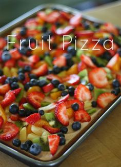 Fruit Pizza: Sugar cookie dough rolled out and baked. Cool completely. Topping 8 oz. cream cheese, softened ½ cup sugar 1 tsp. vanilla extract 1 container Cool Whip, thawed Assorted Fresh Fruit For topping, blend cream cheese, sugar, and vanilla. Fold in Cool Whip. Spread cream cheese mixture over crust. Arrange fruit over cream cheese mixture. Store in refrigerator.