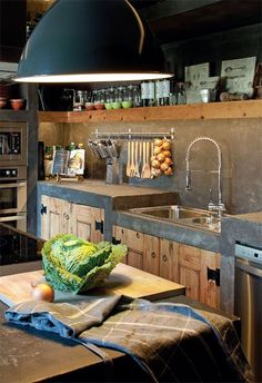 Concrete and wood kitchen cabinets