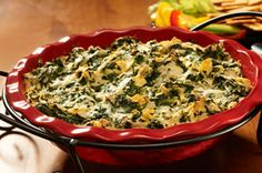 rep time: 10 min Total time: 30 min Makes: 24 servings, about 2 Tbsp. each What You Need 1 can (14 oz.) artichoke hearts, drained, chopped 1 pkg. (10 oz.) frozen chopped spinach, thawed, well drained 1 cup Alfredo sauce 1 cup KRAFT Shredded Mozzarella Cheese 1/3 cup KRAFT Grated Parmesan Cheese 4 cloves garlic, minced Make It Heat oven to 350°F. Mix ingredients until blended.  Spoon into 9-inch quiche dish or pie plate. Bake 20 min. or until lightly browned.