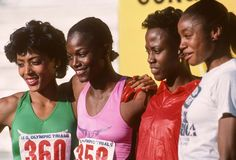 American track and field runners Florence Griffith Joyner (with mile-long scarlet nails), Valerie Brisco-Hooks, Randy Givens, and Brenda Cliette, 1984.