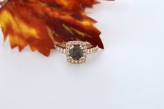 Cushion cut 1.09 carat chocolate diamond with a halo of diamonds and side diamonds in 14K rose gold.