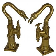 A PAIR OF ANTIQUE FIGURAL BRASS BEER TAPS