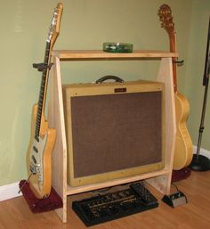 Hello and thank you for visiting my Shop!!  I build these as ordered and will have ready to ship within 10 business days of order/payment.  Very sharp amplifier and guitar stand. Holds two electric guitars and was built to hold a Fender Deville tube amplifier.  Has a slight tilt back for better sound projection and has a raised edge at back to keep amp in place. Stands measure 35 high by 41 wide and 11 1/4 deep. Top shelve measures 27 3/4 by 7 1/4 Inside amplifier area dim...
