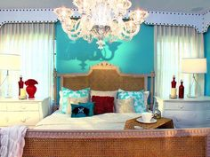 The Mediterranean bedroom uses colors of the sea to create a relaxing bedroom retreat. Red accessories add interest and vibrancy to the space; Love the bed and white nightstands. color of walls. Kuala Lampur, Bedroom Decorating Tips, Bedroom Ideas, Bedroom Makeovers, Mediterranean Bedroom, Turquoise Walls, Red Turquoise, Interior Design Themes, Comfort Mattress