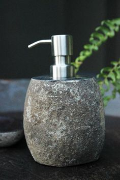 Go back to nature with this cylindrical stone soap dispenser Beautifully cut and exposing smooth stone on the top you can build a great bathroom