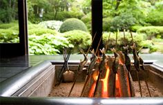 Irori (japanese fire pit) being used to cook skewered fish