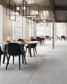 Used by the masters of contemporary architecture, concrete-look tile has established itself as a surface to the most refined of projects. While it may look solid from a distance, the Plain collection is rich with detailed marks and shades that bring your projects to life 🖤 Concrete Look Tile, Porcelain Tile, Contemporary Architecture, Masters, Distance, Surface, Shades, Restaurant, Table