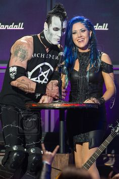 Doyle Wolfgang von Frankenstein of The Misfits, left, and Alissa White-Gluz of Arch Enemy speak on stage at the 6th Annual Revolver Golden Gods Award Show at Club Nokia on April 23, 2014 in Los Angeles, California. (Photo by Paul A. Hebert/Press Line Photos)