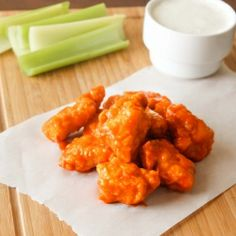 Tender, juicy, fried chicken nuggets coated in hot sauce.
