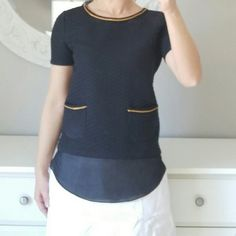 Designer Waggoner Paris Layered Quilted Blouse XXS In brand new condition. Designer is French. Hard to see in photo but top is quilted texture material with layered shirt tail portion. Has gold neckline detail and two pockets in front with gold detail. Tag says color is black, but I think it looks more navy/black to me. Tag says size S, but I wear XS and if I was any bigger this wouldn't fit. Could fit an XXS a little looser. Waggoner Paris Tops