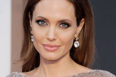 Angelina's light eyes really stand out from her dark brown hair. She looks great in clear & striking colours!