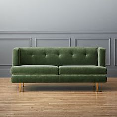 Great green sofa perfect against the grey wall.