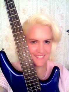 Keri with her ibanez bass guitar .