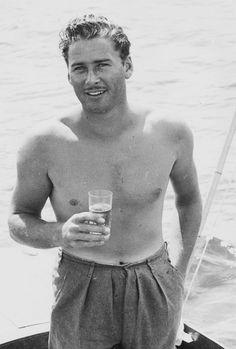 Errol Flynn looking far too gorgeous.