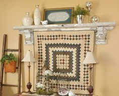 Insert a tension rod between a salvage-style shelf's corbel brackets to create a custom quilt rack.