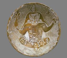 Bowl with seated figure (top)
