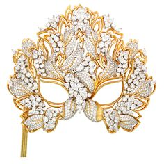 """The Elizabeth Taylor Diamond """"Lachrymosa"""" Mask for amfAR 1993 USA $3000000 1993 In 1993, Henry Dunay designed and made ''The Lachrymosa'' mask for Elizabeth Taylor with the proceeds benefitting the American Foundation for AIDS Research -amfAR. The '' The Lachrymosa'' mask represent the weeping and tears that Elizabeth Taylor and Dunay viewed the AIDS epidemic.The Mask is set with over 130 carats of diamonds in gold and platinum .Dunay is the four time winner of the Diamond International aw..."""