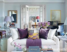 In the living room of this Manhattan apartment, designer Alexander Doherty painted the walls painted Pavilion Gray, and the trim is Lamp Room Gray, both from Farrow & Ball. A blue-and-white Qing dynasty lamp and a 20th-century painting by Michael McGuigan, behind the piano, reflect the owners' wide-ranging connoisseurship.