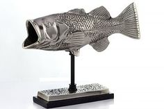 Wide Mouth Bass Bajo Fish Sculpture On Stand 3024 by Day Accents - Wide Mouth Bass Bajo Fish Sculpture On Stand 3024 by Modern Day AccentsSku: 3024Manufacture: Modern Day AccentsCategory: BookshelfFinish: silver and blackMaterial: aluminum/stoneDecor Style: transitionalUnits In Stock: 17Qty Per Pack: 1UPC: 706626030246Dimensional Weight: 12.99Dimension(in Inches): 12L x 3W x 9.5H, Weight: 3.55Packed Dimension(in Inches): 21L x 8W x 15H, Weight: 9Features: Solid Brass Casting Nickel Plated…