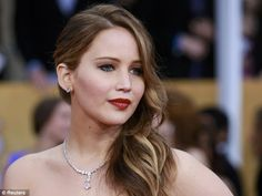 Classic Hollywood: Looking like the icons of yesteryear, the Hunger Games star wore her hair swept to the side with bright red lips showing off her stunning Chopard jewels
