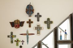 A collection of Mexican crosses on the office wall of a home in Battersea, London.