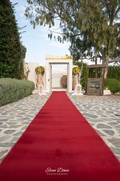 Red capret for your wedding reception entrance.  #weddingingreece #weddingdeco