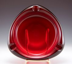 "Santa's Ruby Red Mid-Century Modern Ashtray    Beautiful ruby red mid-century modern tri-corner ashtray by Viking Art Glass.  Made in the 1960s-1970s.  In like-new condition with partial sticker still applied.   Quality vintage glass, beautiful deep ruby color.  Three fat, level rests for cigars or smaller.   Large, weighs 4 lbs.  Measures 8"" long on 3 sides. 2"" deep. Original 1960s Viking catalog part no. 1099.    Perfect for your cigar smoking Santa!"