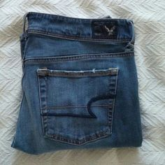 "American Eagle Boot Cut Jeans Inseam Measures 31"" / *Flawed. One hole at the base of the belt loop on the right side. Slight wear on the bottom of each leg. Discounted price for flaws. American Eagle Outfitters Jeans Boot Cut"
