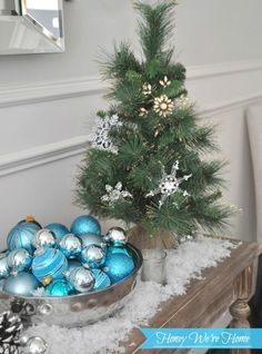 Snowy Aqua  Loving this tree with burlap.. You can buy at Micheal's or Joann's for 8.99 and up... Bought the tree and put lights and ornaments on it..