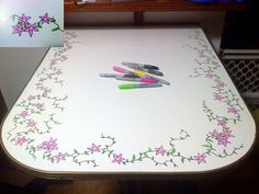 Travel trailer table fixed up as additional counter space in a small kitchen.   Step one) Sand surface lightly  Step two) Paint the whole surface (up to the metal edges) with white paint.  Step three) Place glow-in-the-dark stickers randomly around edge.  Step four) Draw flowers around the glow-in-the-dark stars so that they are the center of each flower.  Step five) Add some flower buds and random vines.  Step six) Seal entire project with a clear coat of epoxy glaze.    Enjoy your new…