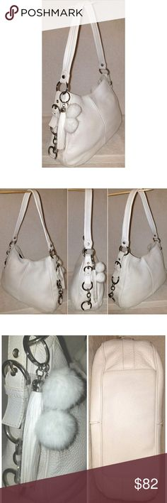 Large white leather hobo handbag Large white leather hobo handbag 9 by 14 by 5.5  with an 11.5 strap drop, one white double pom pom with one white tassel embellishment, 1 inside slip pocket.  This beautiful Italian made leather handbag has been gently loved and professionally refurbished in  excellent condition, looks and feels brand new. coach Bags Shoulder Bags