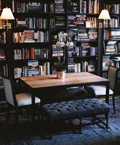 dining room doubles as a library with tall bookshelves, decent lighting, and some comfortable seats - what a great idea!