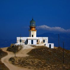 """The legendary lighthouse of Armenistis Mykonos. Constructed in 1890 after the sinking of """"Volta"""" steamboat. You can visit by car driving a dirt road, or you can have a distant look when sailing from Mykonos to Tinos island. Greece has more than 1300 lighthouses, with the oldest dating back to 1834 at Siros Island port entrance. For more travel news visit www.bestravelvideo.com #lighthouse #faros #armenistis #travelblogger #travel #mykonos #mykonostown #mykonos2015 #μυκονος #insta_greece Dirt Road Anthem, Mykonos Town, Mykonos Island, Steamboats, Travel News, Lighthouses, Entrance, Sailing, Greece"""