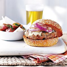 Fresh off the grill, juicy pork burgers topped with gooey Gruyère cheese can stand up to any beef burger. They shrink as they cook, so try to form patties that are slightly larger in diameter than the buns. Burger Fresh, Pork Recipes, Cooking Recipes, Burger Mania, Pork Burgers, Pork Dishes, Quick Easy Meals, Love Food, Food Porn