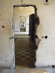 Doors : The old school building was converted into a jail and walls broken through to create a constant flow of despair....  Cambodia - Phnom Pehn S.21 Prison now known as the Tuol Sleng Genocide Museum
